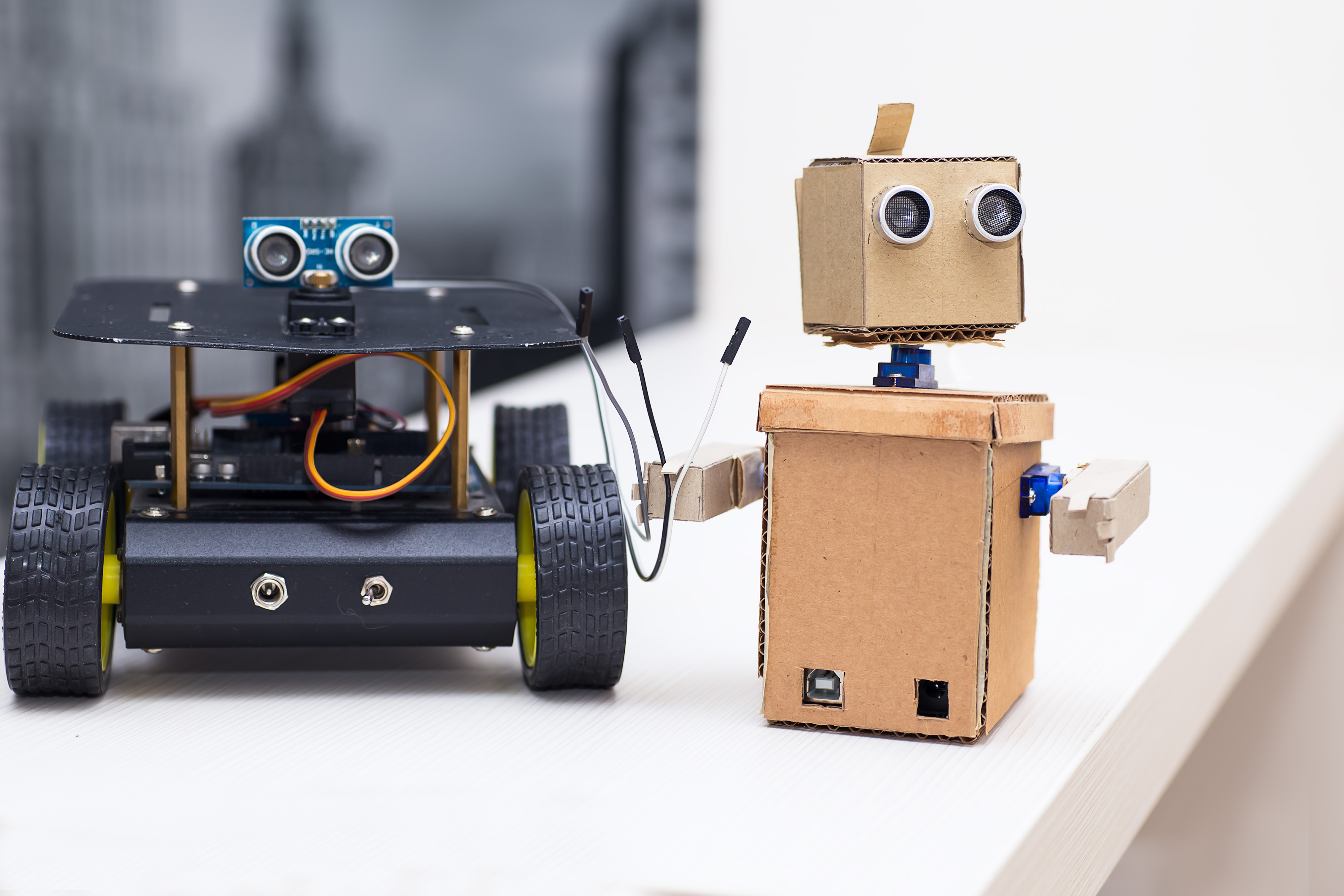 robot keeps wires and stands next to the other robot